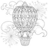 Hand drawn doodle outline  air baloon in flight Stock Image