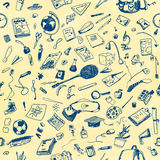 Hand drawn doodle school objects seamless pattern. Blue pen objects, pale yellow watercolor painted background. Learning Royalty Free Stock Images
