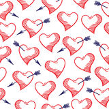 Hand-drawn doodle seamless pattern with hearts. Stock Photos