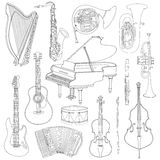 Hand drawn doodle, sketch musical instruments. Vector icons set Stock Images