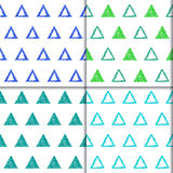 Hand drawn doodle triangle seamless patterns set. Stock Photos