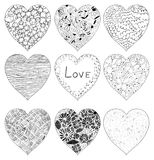 Hand drawn doodle vector hearts. In black with strokes, lines and floral elements vector illustration