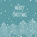 Hand Drawn Doodle White Fir Trees in Forest Snowfall Merry Christmas Hand Lettering. Baby Blue Background. Abstract. Greeting card Royalty Free Stock Photo