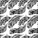 Hand drawn dotted feathers set on white background Stock Image