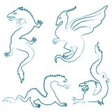Hand drawn dragon silhouettes set Royalty Free Stock Image