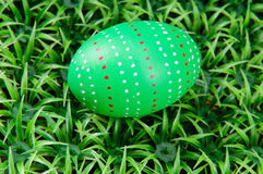 Hand-drawn Easter egg. Hand-drawn green Easter egg on on artificial green grass Royalty Free Stock Images