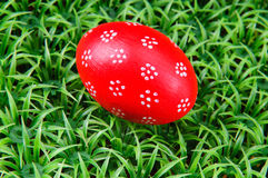 Hand-drawn Easter egg. Hand-drawn red Easter egg on on artificial green grass Royalty Free Stock Photo