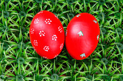 Hand-drawn Easter egg. Hand-drawn red Easter eggs on on artificial green grass Royalty Free Stock Image