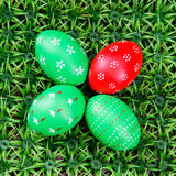 Hand-drawn Easter eggs. Four hand-drawn colorful Easter eggs on on artificial green grass Royalty Free Stock Photography
