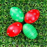 Hand-drawn Easter eggs. Four hand-drawn colorful Easter eggs on on artificial green grass Royalty Free Stock Image