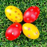 Hand-drawn Easter eggs. Four hand-drawn colorful Easter eggs on on artificial green grass Stock Image