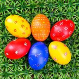 Hand-drawn Easter eggs. Lot of hand-drawn  Easter eggs with plate on on artificial green grass Royalty Free Stock Photo