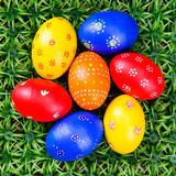 Hand-drawn Easter eggs. Lot of hand-drawn  Easter eggs with plate on on artificial green grass Royalty Free Stock Images