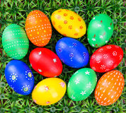 Hand-drawn Easter eggs. Lot of hand-drawn  Easter eggs with plate on on artificial green grass Royalty Free Stock Photography