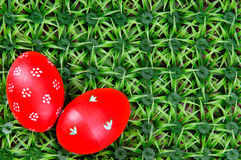 Hand-drawn Easter eggs. Hand-drawn red Easter eggs on on artificial green grass Royalty Free Stock Images