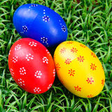 Hand-drawn Easter eggs. Three hand-drawn colorful Easter eggs on on artificial green grass Royalty Free Stock Image