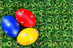 Hand-drawn Easter eggs. Three hand-drawn colorful Easter eggs on on artificial green grass Stock Photos