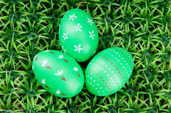 Hand-drawn Easter eggs. Three hand-drawn green Easter eggs on on artificial green grass Royalty Free Stock Photography