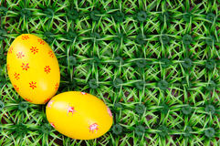 Hand-drawn Easter eggs. Hand-drawn yellow Easter egg on on artificial green grass Royalty Free Stock Photography