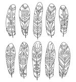 Hand drawn ethnic feathers set isolated on white background. Collection of tribal elements. Template for coloring book. Hand drawn ethnic feathers set isolated stock illustration