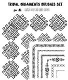Hand-drawn ethnic ornamental brushes set. Hand-drawn tribal ethnic ornamental brushes set. Artistic vector collection of design elements tribal geometric Stock Photos