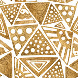 Hand drawn ethnic pattern. Seamless gold background. Stock Images