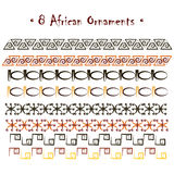 Hand-drawn ethno African ornaments. Set of eight abstract hand-drawn ethnic African ornaments: black, red, umber and yellow sketches.  on white background. Good Royalty Free Stock Image