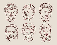 Hand-drawn faces of children. sketch. vector Stock Photos