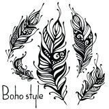 Hand drawn feathers. ink vector illustration. boho style design elements. ethnic creative doodles. isolated on white Stock Photo