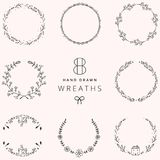 Hand Drawn Floral Wreath Frames. Set of 8 Doodle Elements. stock photo