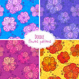 Hand drawn flower seamless patterns set Stock Photos