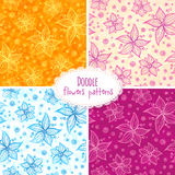Hand drawn flower seamless patterns set Stock Images