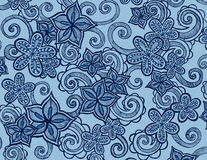 Hand drawn flowers on blue background with curls and swirls Royalty Free Stock Photos