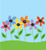 Hand drawn flowers in field Royalty Free Stock Image