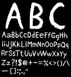 Hand drawn font. In black background Royalty Free Stock Photo