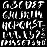 Hand drawn font made by dry brush strokes. Grunge style alphabet Stock Photos