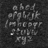 Hand drawn font on textured paper black background Stock Images