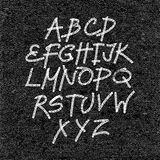Hand drawn font on textured paper black background Stock Photos
