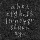 Hand drawn font on textured paper black background Stock Photography