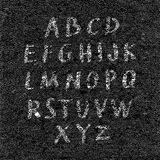 Hand drawn font on textured paper black background Royalty Free Stock Image