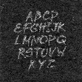 Hand drawn font on textured paper black background Royalty Free Stock Photos