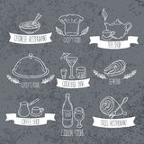Hand drawn food and drinks labels. Doodle emblems on grunge background Stock Image