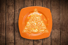 Hand drawn food pyramid on colorful dish plate Stock Photography