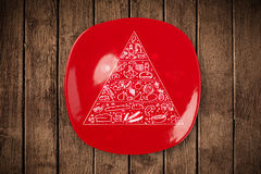 Hand drawn food pyramid on colorful dish plate Royalty Free Stock Image