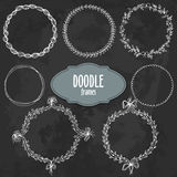Hand drawn frames set in floral style on black background. Hand drawn frames set in floral and lines style, white contour vector borders on black grunge Stock Photos