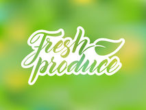 Hand drawn fresh produce lettering against blurred background Royalty Free Stock Images