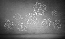 Teamwork concept by means of gear mechanism. Hand drawn gear mechanism presented on gray wall. 3D rendering Stock Photos