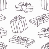 Hand drawn gift box outline seamless pattern in. Hand drawn cartoon gift box outline seamless pattern. Doodle holiday vector background in black and white Stock Photography