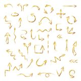 Hand drawn gold arrows set made of chalk or pastel texture, vector illustration stock photo