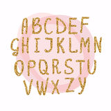 Hand drawn golden glitter letters. Font for for your designs: t- Stock Images
